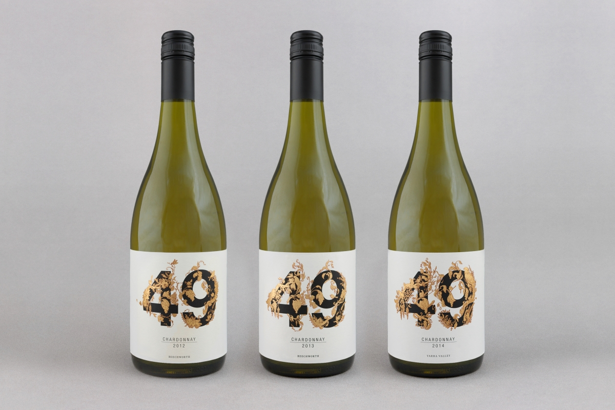 Wine bottles showing the 2012, 2013 & 2014 labels.